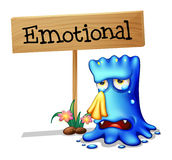 A very emotional monster near a signboard Stock Photos
