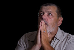 Very emotional portrait of a praying senior man Royalty Free Stock Photo