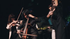 Three Violinist Fun And Provocatively Playing On Stage  Excellent