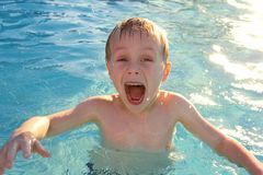 Very Excited Child Swimming in Pool Stock Images