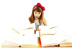 Very excited schoolgirl with open books Stock Photo