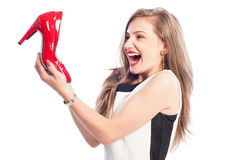 Very excited woman holding high heel red shoes Royalty Free Stock Image
