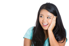 Very excited young woman holding her head in amazement Royalty Free Stock Images