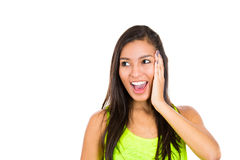Very excited young woman holding her head in amazement Stock Images