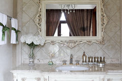 Very exquisite bathroom mirror. Very delicate side mirror, gold-plated taps, the ceramic tile of quietly elegant nobility and mesa Royalty Free Stock Photography