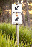 Very Faded Sign in Nature Reserve: No Dogs, No Cats Stock Photo