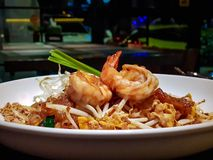 Very famous thai food, Fried noodle seasoned with special sauce. Mixed with eggs, shrimps and bean sprouts or Pad Thai in Thai language served in the white dish royalty free stock photos