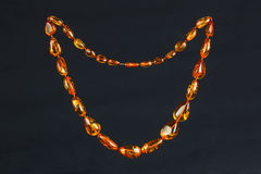 Very fashionable beads made of amber Royalty Free Stock Photography