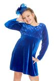 Very fashionable girl in a blue velvet Royalty Free Stock Photography