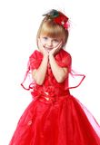 Very fashionable little girl in a long bright red Stock Image