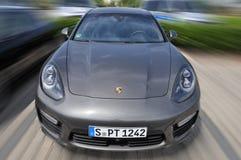 Very fast speeding Porsche Panamera Stock Photos