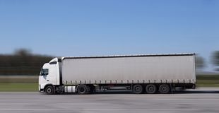 Very fast a 18 wheeler truck driving on the highway. stock photography
