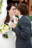 The very first kiss of newlyweds after they gave oathes Royalty Free Stock Photos