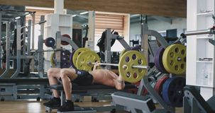 A very fit guy in an athletes gym, works on some very heavy weights , he is being healthy. 4k stock footage