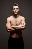 Very fit ripped young athlete. Royalty Free Stock Photos
