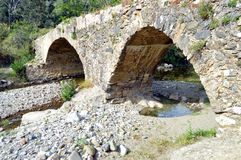 Very former bridge in stone. Very former bridge in stones with two arches Stock Photography