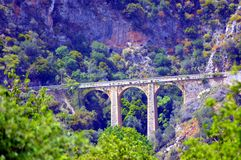 Very former bridge in stones. Royalty Free Stock Photo