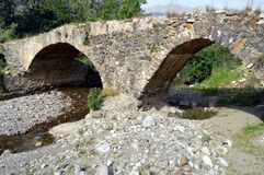 Very former bridge in stones. Very former bridge in stones with two arches Royalty Free Stock Image