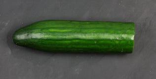 Very fresh green cucumber on slate Royalty Free Stock Photo
