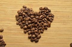 Roasted coffee beans heart shaped Royalty Free Stock Photos