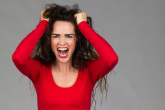 Very frustrated angry woman screaming Stock Photo