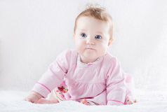 Very funny baby girl in a pink dress Royalty Free Stock Photography