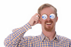 Very funny young man. With toys on his eyes Stock Images