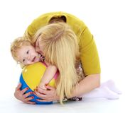 Very gentle mother kisses her cute little daughter Stock Image