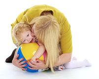 Very gentle mother tenderly embracing his beloved Stock Image