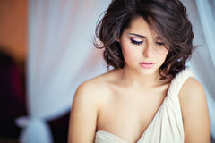 Very gentle sensual girl brunette in a beige dress , close up Royalty Free Stock Photography