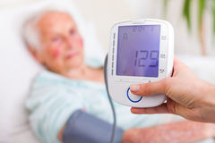 Very good blood pressure of senior woman Stock Photo