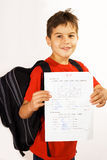 A very good mark. Young boy showing his good qualifications royalty free stock photography