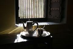 Very Good Morning Tea set with shining silver utensils, Morning sunrise light coming through window is shining on the silverware Royalty Free Stock Photography