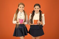 A very good morning to you. Little children drinking morning tea or coffee. Cute schoolgirls holding tea cups. School stock photos