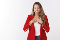 Very grateful young cute friendly-looking charming woman holding palms breast thankful smiling broadly thanking saviour. Help, receiving heartwarming gift royalty free stock photography