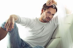 Very handsome man in serious pose Stock Photos