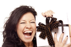 Very happiness girl holds a gift Stock Images