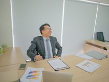 Very Happy asian business man in the office stock photos