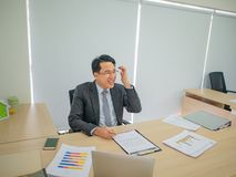 Very Happy asian business man in the office royalty free stock photo