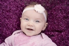 Very Happy infant smiling at camera stock images