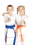 Very happy boy and girl athletes in karategi Royalty Free Stock Photography