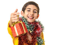 Very happy boy giving Christmas gift Royalty Free Stock Photos