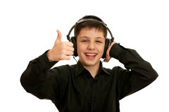 Very happy boy with headphones Stock Images