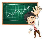 A very happy businessman in front of blackboard Stock Image