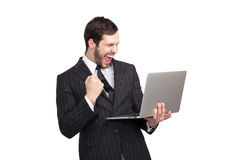 Very happy businessman with a laptop royalty free stock photography