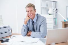 Very happy businessman at work Stock Photos