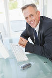Very happy businessman at work Royalty Free Stock Photos