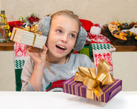 Very happy child with gift box for Christmas. Royalty Free Stock Photography