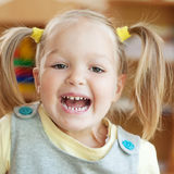 Very happy child. Little girl laughs Royalty Free Stock Photos
