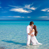 Very happy couple enjoy each other on the beach Stock Photography